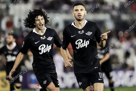 Ivan Franco (L) and Adrian Martinez (R) of Club Libertad celebrate after scoring during the final of Copa Paraguay soccer tournament between Club Libertad and Club Guaraniat at Defensores del Chaco stadium in Asuncion, Paraguay, 04 December 2019.
