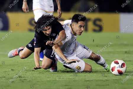 Ivan Franco (L) of Libertad vies for the ball with Guillermo Benitez of Guarani (R) during the final of Copa Paraguay soccer tournament between Club Libertad and Club Guaraniat at Defensores del Chaco stadium in Asuncion, Paraguay, 04 December 2019.