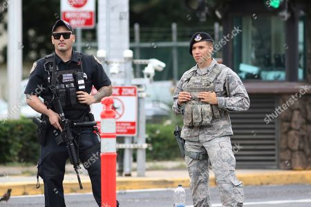 Stock Image of Security stands outside the main gate at Joint Base Pearl Harbor-Hickam, in Honolulu. A shooting at Pearl Harbor Naval Shipyard in Hawaii left at least one person injured Wednesday, military and hospital officials said. Joint Base Pearl Harbor-Hickam spokesman Charles Anthony confirmed that there was an active shooting at Pearl Harbor Naval Shipyard