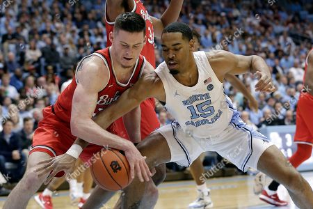 Ohio State forward Kyle Young, left, and North Carolina forward Garrison Brooks (15) reach for the ball during the first half of an NCAA college basketball game in Chapel Hill, N.C