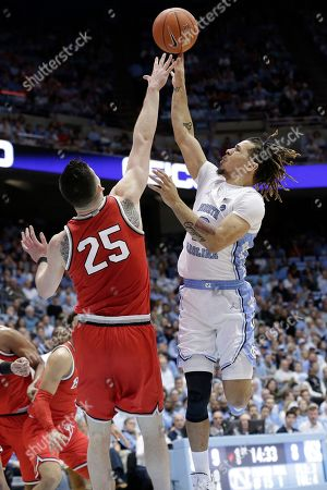 Stock Image of North Carolina guard Cole Anthony (2) drives to the basket while Ohio State forward Kyle Young (25) defends during the first half of an NCAA college basketball game in Chapel Hill, N.C