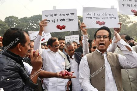 "Stock Image of Indian lawmaker and former Finance Minister Palaniappan Chidambaram, center, holds a placard that reads ""Why is the Modi government silent on the rise of onion prices, participates in a protest against the rise in onion prices, outside the Indian parliament in New Delhi, India, . Chidambaram was released by an order from India's Supreme Court on Wednesday on bail in a case involving alleged bribery and money laundering benefitting his son's company"