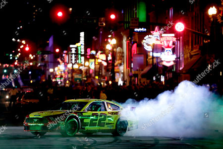 Stock Picture of Joey Logano does a burnout in the Burnouts on Broadway competition, during NASCAR Champion's Week in Nashville, Tenn