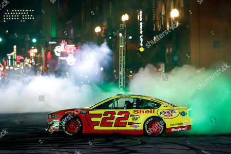 Joey Logano does a burnout in the Burnouts on Broadway competition, during NASCAR Champion's Week in Nashville, Tenn