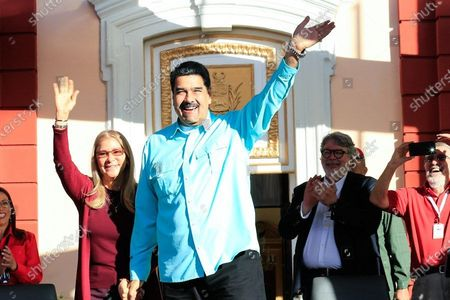 A handout photo made available by Miraflores Palace's Press Office shows the President of Venezuela, Nicolas Maduro (C), waving as he attends a government event in Caracas, Venezuela, 04 December 2019. According to local media reports, Maduro said that Bolivia is preparing for Evo Morales' return. Former Bolivian President Evo Morales resigned after protests erupted in Bolivia in the aftermath of contested presidential election results.