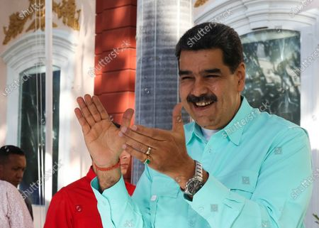 A handout photo made available by Miraflores Palace's Press Office shows the President of Venezuela, Nicolas Maduro (C), reacting as he attends a government event in Caracas, Venezuela, 04 December 2019. According to local media reports, Maduro said that Bolivia is preparing for Evo Morales' return. Former Bolivian President Evo Morales resigned after protests erupted in Bolivia in the aftermath of contested presidential election results.