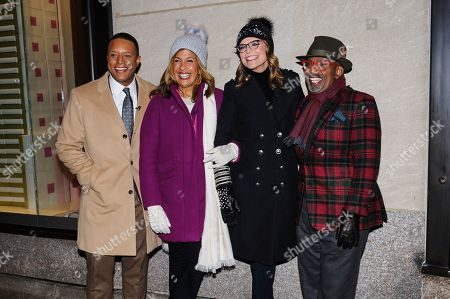 Craig Melvin, from left, Hoda Kotb, Savannah Guthrie, and Al Roker pose for a photo during the 87th annual Rockefeller Center Christmas tree lighting ceremony, in New York