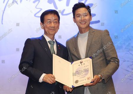South Korean actor Lee Jung-jin (R) poses with Interior Minister Chin Young (L) after being appointed a goodwill ambassador for volunteer work at a National Volunteers Convention in Seoul, South Korea, 05 December 2019.