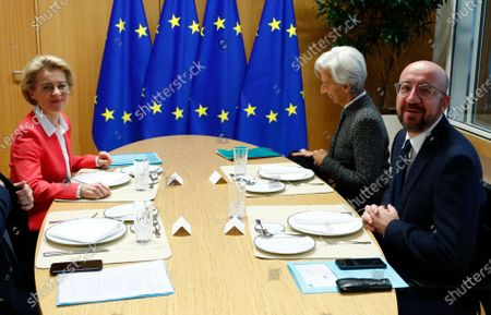 European Council President Charles Michel (R) attends a meeting with European Commission President Ursula von der Leyen (L), Eurogroup President Mario Centeno (not pictured) and European Central Bank (ECB) President Christine Lagarde (2-R) in Brussels, Belgium, 05 December 2019.