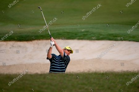 Stock Image of Greg Chalmers (AUS) hits out of the bunker