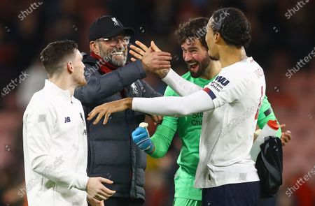Liverpool manager Jurgen Klopp celebrates at full time with his defence and Alisson Becker of Liverpool after a rare clean sheet