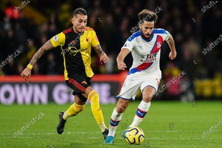 Andros Townsend of Crystal Palace runs the ball past Roberto Pereyra of Watford