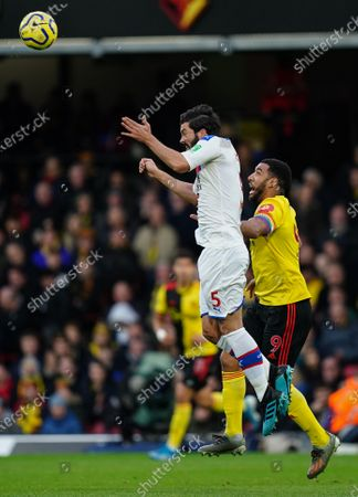 James Tomkins of Crystal Palace wins a header over Troy Deeney of Watford