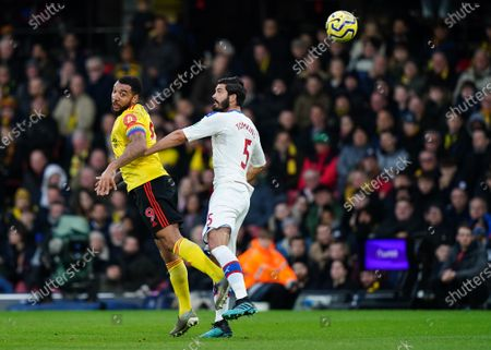 Stock Photo of Troy Deeney of Watford wins a header over James Tomkins of Crystal Palace