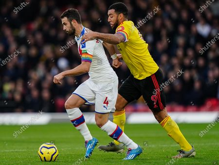 Stock Image of Troy Deeney of Watford challenges Luka Milivojevic of Crystal Palace