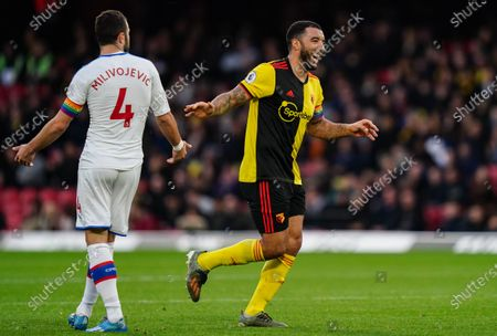 Stock Picture of Troy Deeney of Watford reacts after challenging Luka Milivojevic of Crystal Palace
