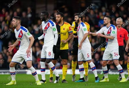 Troy Deeney of Watford lines up alongside the Crystal Palace defence for a Watford free-kick
