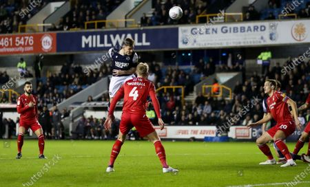 Stock Image of Ben Thompson of Millwall gets for an early headed chance