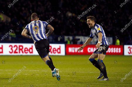 Sheffield Wednesday's Sam Hutchinson celebrates with  Steven Fletcher