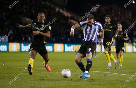 Sheffield Wednesday's Steven Fletcher has this shot saved