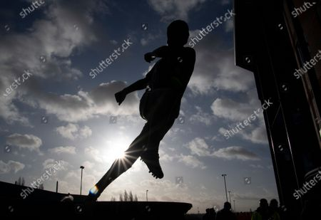 A silhouette of the Tony 'Bomber' Brown statue outside the Hawthorns Stadium