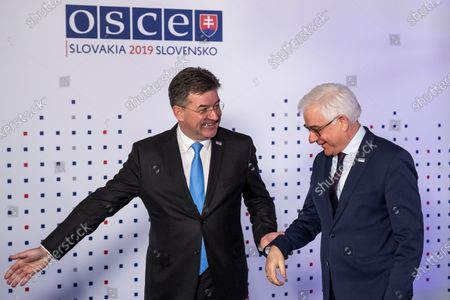 Slovak Minister of Foreign Affairs Miroslav Lajcak (L) welcomes Polish Foreign Minister Jacek Czaputowicz (R) ahead of the 26th Organization for Security and Co-operation in Europe (OSCE) Ministerial Council in Bratislava, Slovakia, 05 December 2019. The 26th OSCE Ministerial Council, bringing together some 57 Foreign Ministers from across the OSCE region, takes place on 05 and 06 December 2019.