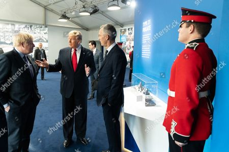 President Donald Trump meets backstage with the Secretary General of the North Atlantic Treaty Organization (NATO) Jens Stoltenberg and the British Prime Minister Boris Johnson