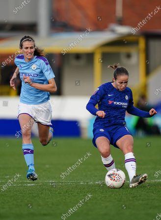 Guro Reiten of Chelsea strikes the ball past Jill Scott of Manchester City
