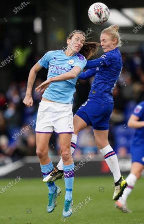 Jill Scott of Manchester City and Sophie Ingle of Chelsea jump to head the ball