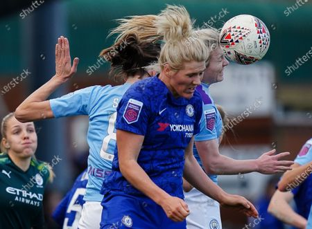 Millie Bright of Chelsea and Jill Scott and Lauren Hemp of Manchester City battle to head the ball