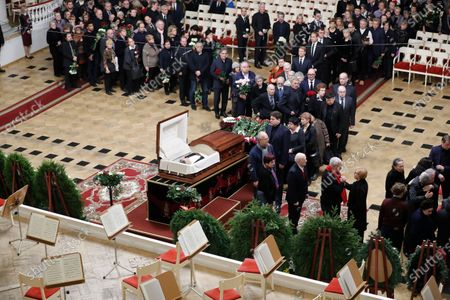 Stock Image of Russian pianist Denis Matsuev (C) condolences to relatives during a farewell ceremony to Latvian-born conductor Mariss Jansons in Grand Hall of Philharmonic in St. Petersburg, Russia, 05 December 2019. Reports on 01 December 2019 state Mariss Jansons has died on 30 December 2019 aged 76 of a heart failure. Jansons worked for leading concert houses, including Vienna Philharmonic, Bavarian Radio Symphony Orchestra, the Amsterdam Royal Concertgebouw Orchestra, Pittsburgh Symphony Orchestra and others.
