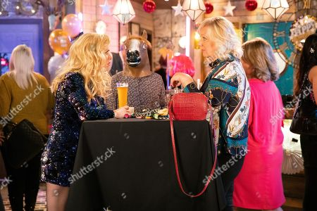 Ep 9967 Tuesday 31st December 2019  Abi Franklin, as played by Sally Carman, arrives at the bistro for the New Year's Eve party and confides in Eileen Grimshaw, as played by Sue Cleaver, that she's got the hots for Kevin Webster. Kevin (in mask) overhears Abi likening him to a boring, safe hatchback.