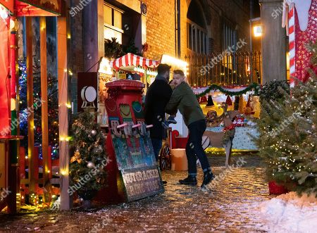 Ep 9961 & 9962 Christmas Day 2019 - Wed 25th Dec 2019 Shona collects the keys to the Winter Wonderland from Michael as the Platts hide presents for David treasure hunt. But when they suddenly find themselves in the middle of a shoot out David is desperate to protect Shona, while Sarah Platt holds Adam Barlow, as played by Sam Robertson, and Harry close. Harry runs and Gary Windass, as played by Mikey North, grabs him. Derek Milligan trains the gun on him.