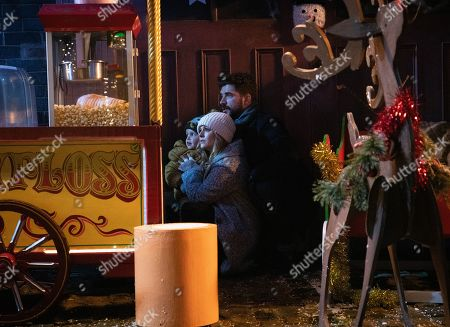 Ep 9961 & 9962 Christmas Day 2019 - Wed 25th Dec 2019 Shona collects the keys to the Winter Wonderland from Michael as the Platts hide presents for David treasure hunt. But when they suddenly find themselves in the middle of a shoot out David is desperate to protect Shona, while Sarah Platt, as played by Tina O'Brien, holds Adam Barlow, as played by Sam Robertson, and Harry close. Harry runs and Gary Windass grabs him. Derek Milligan trains the gun on him.