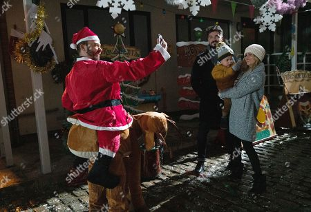 Ep 9961 & 9962 Christmas Day 2019 - Wed 25th Dec 2019 Shona collects the keys to the Winter Wonderland from Michael as the Platts hide presents for David Platt's, as played by Jack P Shepherd, treasure hunt. But when they suddenly find themselves in the middle of a shoot out David is desperate to protect Shona, while Sarah Platt, as played by Tina O'Brien, holds Adam Barlow, as played by Sam Robertson, and Harry close.