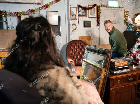 Stock Photo of Ep 9956 Friday 20th December 2019 - 1st Ep Derek explains to Izzy he needs money to take his kids on a promised holiday to Florida or he'll lose them forever so Izzy Armstrong, as played by Cherylee Houston, approaches Gary Windass, as played by Mikey North, for a loan to fund her share of the £10k. Gary's seething that Derek's trying to sell a building that actually belongs to him.