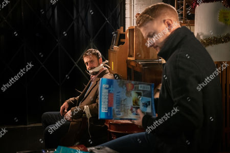 Stock Picture of Ep 9959 Monday 23rd December 2019 - 2nd Ep Gary Windass, as played by Mikey North, locks a tied up Derek, as played by Craige Els, in the furniture shop overnight, determined to make sure he misses his flight to Florida with his kids.