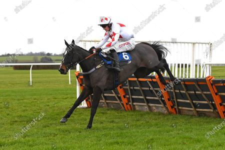 Winner of The Hunts Food Service Mares' Maiden Hurdle Kissesforkatie ridden by Nick Scholfield and trained by Jeremy Scott during Horse Racing at Wincanton Racecourse on 5th December 2019