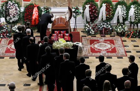 Stock Photo of Musicians pass by the coffin of Mariss Jansons during a memorial ceremony in the Great Philharmonic Hall in St.Petersburg, Russia, . Mariss Jansons, conductor of top classical ensembles including the Pittsburgh Symphony Orchestra and the Royal Concertgebouw Orchestra in Amsterdam, has died in Russia. He was 76