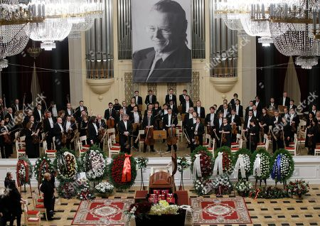 Orchestra musicians stand on stage next to the coffin of Mariss Jansons during a memorial ceremony in the Great Philharmonic Hall in St.Petersburg, Russia, . Mariss Jansons, conductor of top classical ensembles including the Pittsburgh Symphony Orchestra and the Royal Concertgebouw Orchestra in Amsterdam, has died in Russia. He was 76
