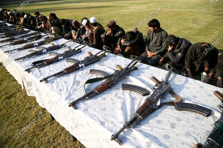 Former militants surrender their weapons during a reconciliation ceremony in Jalalabad, Afghanistan, 05 December 2019. A group of 180 former Taliban and Islamic State (IS) members on 05 December laid down their arms in Jalalabad and joined the peace process. Under an amnesty launched by former President Hamid Karzai and backed by the US in November 2004, hundreds of anti-government militants have surrendered to the government.