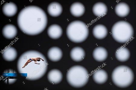 Gold medalist Gary Hunt of Britain dives during the men's high diving competition at the World Swimming Championships in Gwangju, South Korea, on
