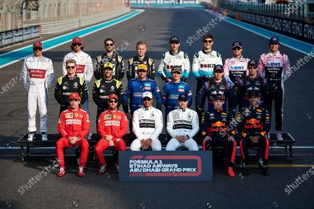Stock Photo of (top L to R) Kimi Raikkonen of Finland, Antonio Giovinazzi of Italy, Romain Grosjean of France, Kevin Magnussen of Denmark, Robert Kubica of Poland, George Russell of Great Britain, Sergio Perez of Mexico, Lance Stroll of Canada, (mid L to R), Nico Hulkenberg of Germany, Daniel Ricciardo of Australia, Carlos Sainz of Spain, Lando Norris of Great Britain, Pierre Gasly of France, Daniil Kvyat of Russia, (low L to R), Charles Leclerc of France, Sebastian Vettel of Germany, Lewis Hamilton of Great Britain, Valtteri Bottas of Finland, Max Verstappen of Netherlands and Alexander Albon of Thailand drivers of the 2019 season pose for a group photo ahead of the Abu Dhabi F1 Grand Prix race at the Yas Marina Circuit in Abu Dhabi.