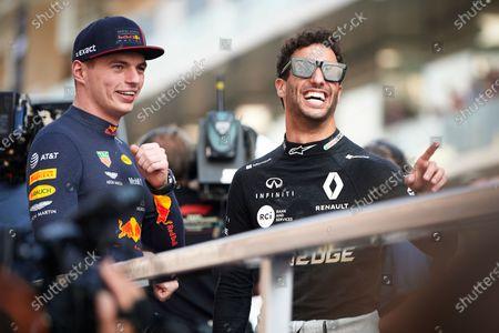 Red Bull Racing's Dutch driver Max Verstappen (L) and Renault Sport F1 Team's Australian driver Daniel Ricciardo attend the drivers parade ahead of the Abu Dhabi F1 Grand Prix race at the Yas Marina Circuit in Abu Dhabi.