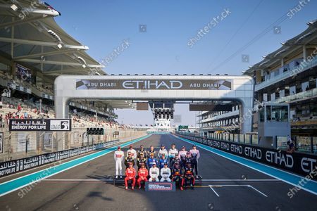 (top L to R) Kimi Raikkonen of Finland, Antonio Giovinazzi of Italy, Romain Grosjean of France, Kevin Magnussen of Denmark, Robert Kubica of Poland, George Russell of Great Britain, Sergio Perez of Mexico, Lance Stroll of Canada, (mid L to R), Nico Hulkenberg of Germany, Daniel Ricciardo of Australia, Carlos Sainz of Spain, Lando Norris of Great Britain, Pierre Gasly of France, Daniil Kvyat of Russia, (low L to R), Charles Leclerc of France, Sebastian Vettel of Germany, Lewis Hamilton of Great Britain, Valtteri Bottas of Finland, Max Verstappen of Netherlands and Alexander Albon of Thailand drivers of the 2019 season pose for a group photo ahead Abu Dhabi F1 Grand Prix race at the Yas Marina Circuit in Abu Dhabi.