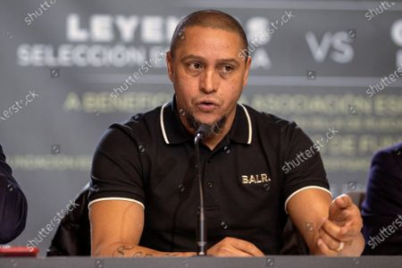 Stock Photo of Former Real Madrid's player Roberto Carlos attends a press conference during the presentation of the charity soccer match between the Spanish national soccer team Legends against GoldStandard World Stars at Wanda Metropolitano stadium in Madrid, Spain, 05 December 2019. The match will be held on 21 December 2019 at Wanda Metropolitano stadium.