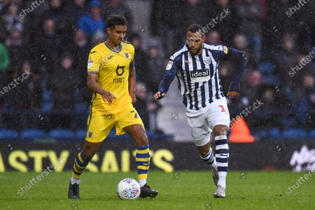 8th December 2019, The Hawthorns, West Bromwich, England; Sky Bet Championship, West Bromwich Albion v Swansea City : Kyle Naughton (26) of Swansea City under pressure from Matt Phillips (10) of West Bromwich AlbionCredit: Gareth Dalley/News Images