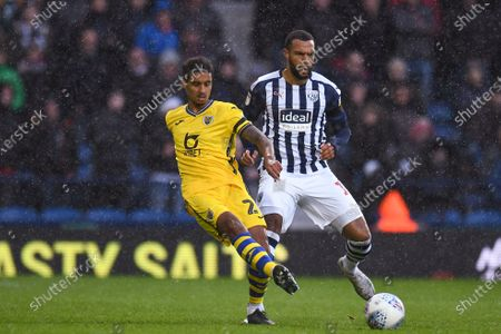 8th December 2019, The Hawthorns, West Bromwich, England; Sky Bet Championship, West Bromwich Albion v Swansea City : Kyle Naughton (26) of Swansea City passes the ball under pressure from Matt Phillips (10) of West Bromwich AlbionCredit: Gareth Dalley/News Images