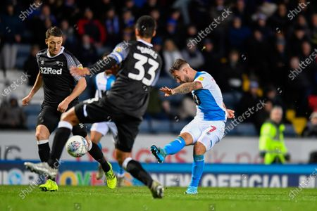 Stock Image of 7th December 2019, Ewood Park, Blackburn, England; Sky Bet Championship, Blackburn Rovers v Derby County : Adam Armstrong (7) of Blackburn Rovers scores a goal to make the score 1-0Credit: Simon Whitehead/News Images