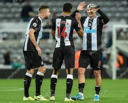 8th December 2019, St. James's Park, Newcastle, England; Premier League, Newcastle United v Southampton : Paul Dummett (3) of Newcastle United, Jonjo Shelvey (8) of Newcastle United and Isaac Hayden (14) of Newcastle United celebrate at full-time
